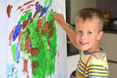 Boy painting, Art can help kids build confidence and self-esteem